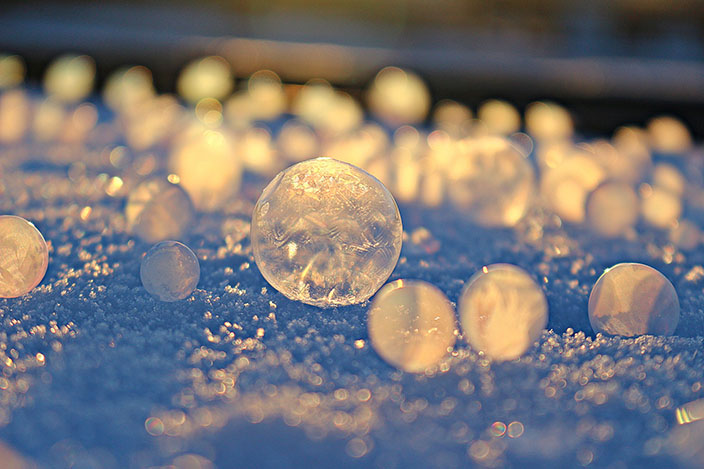 Frozen bubbles on a winter ground
